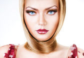 Blond woman with blue eyes and hair around neck — Stock Photo