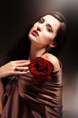 Chocolate colored attractive woman with red rose — Stock Photo