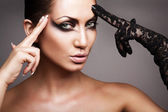 Close up portrait of woman with black glove — Stock Photo