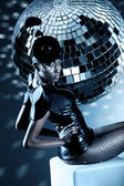 Attractive african woman with disco ball — Stock Photo