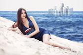 Woman saw mirage on the sea beach — Stock Photo