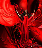 Goddess of love in red dress with magnificent hair and hearts on — Stock Photo