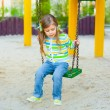 Happy little girl on swing — Stock Photo #10164104