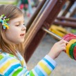 A cute young girl having fun on the playgroung — Stock Photo #10164106