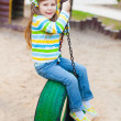 Happy childhood - portrait of swinging girl — Stock Photo