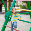 A cute young girl having fun on the playgroung — Stock Photo