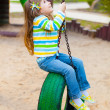 Happy childhood - portrait of swinging girl — Stock Photo #10164129
