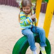 Happy childhood - portrait of swinging girl — Stock Photo #10164131