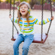 Happy childhood - portrait of swinging girl — Stock Photo #10164133