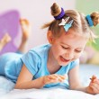 Happy cute child painting in her room — Stock Photo