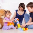 Happy parents playing with child at home — Stok fotoğraf