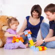 Happy parents playing with child at home — Stock fotografie
