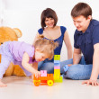 Happy familly playing playing with blocks — Stock Photo