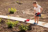 Little girl gardening in summer day — Stock Photo