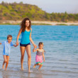 Royalty-Free Stock Photo: Mother with children running at the beach