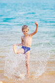Happy boy in the sea — Stock Photo
