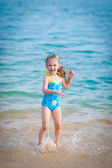 Happy girl in the sea. Fun with water drops — Stock Photo