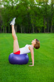 Young woman making fitness exercises — Stock Photo