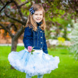 Stock Photo: Fashionable sweet girl in a spring garden