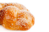 Sweet bread with sesame isolated on white — Stock Photo