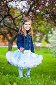 Fashionable sweet girl in a spring garden — Stock Photo