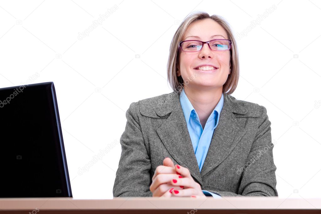 Cute business woman wearing spectacles, working on a laptop  Stock Photo #9195481