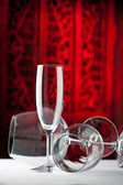 Red white champagne glasses on a table — Stock Photo