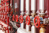Red steam valves and pipes — Stock Photo