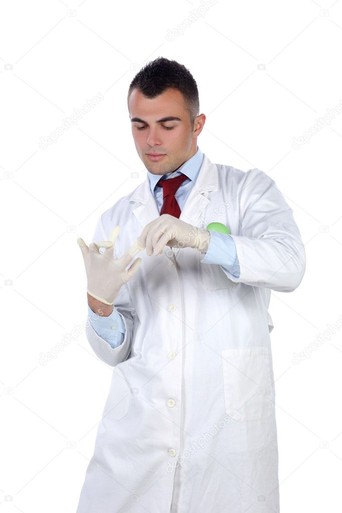 Young doctor standing and taking off his rubber gloves — Stock Photo #10581777