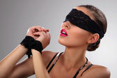 Attractive blindfolded girl close up — Stockfoto