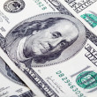 Stock Photo: Few hundred dollar bills close up 2