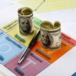 Hundred dollar bills and a pen on swot analysis — Stock Photo