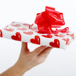 Stock Photo: Female hand holding gift