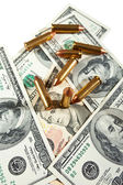 Bullets and dollars — Stock Photo