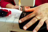 Woman sewing, closeup of hands — Stock Photo