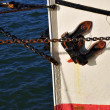 Detail of old sailing boat in blue red and white — Stock Photo #8404820