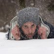 Young man blowing snow — Stock Photo
