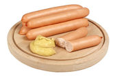 Frankfurters on wooden board — Stock Photo