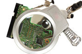 Third hand magnifier with electronic circuit — Stock Photo