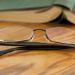 Book with reading glasses — Foto Stock