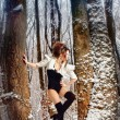 Stock Photo: Fairy girl in winter forest among the trees