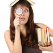 Girl student with books and magnifying glass — Stock Photo
