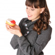 Woman at gray dress with donut — Stock Photo
