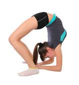 Adolescente en poses de gimnasia — Foto de Stock
