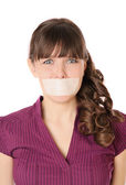 The girl with tape sealed her mouth — Stock Photo
