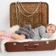 The girl was tired and lay down to rest in a suitcase — Stock Photo