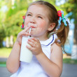 Royalty-Free Stock Photo: Girl drinking a milkshake through a straw