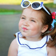 Girl in sunglasses tricked their cheeks — Stock Photo