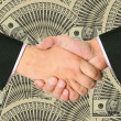 Business transaction is backed by a handshake — Stock Photo #9832295