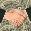 Stock Photo: Business transaction is backed by handshake
